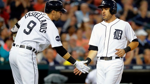 Detroit Tigers' Ian Kinsler, right, celebrates after scoring with Nicholas Castellanos (9) on a Miguel Cabrera (24) single against the Kansas City Royals in the sixth inning of a baseball game in Detroit, Monday, July 24, 2017. (AP Photo/Paul Sancya)