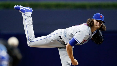 New York Mets starting pitcher Jacob deGrom (48) works against a San Diego Padres batter during the first inning of a baseball game Monday, July 24, 2017, in San Diego. (AP Photo/Gregory Bull)