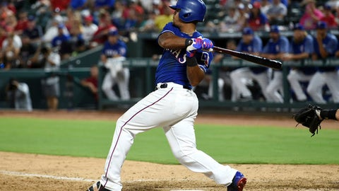 Texas Rangers third baseman Adrian Beltre follows through on his fourth single of a baseball game during the ninth inning against the Miami Marlins, Monday, July 24, 2017, in Arlington, Texas. (AP Photo/Jeffrey McWhorter)