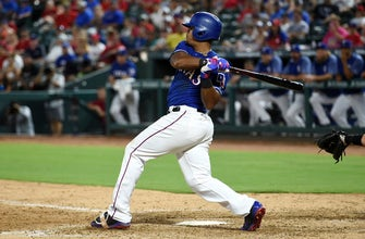 Images of Rangers seek clutch hits in rubber match against Marlins
