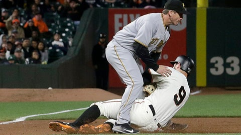 Pittsburgh Pirates third baseman David Freese, left, tags out San Francisco Giants' Brandon Belt during the fifth inning of a baseball game in San Francisco, Monday, July 24, 2017. (AP Photo/Jeff Chiu)