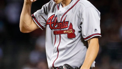Atlanta Braves relief pitcher Matt Wisler (45) adjusts his cap after giving up a three run home run to Arizona Diamondbacks' J.D. Martinez during the six inning of a baseball game, Monday, July 24, 2017, in Phoenix. (AP Photo/Matt York)