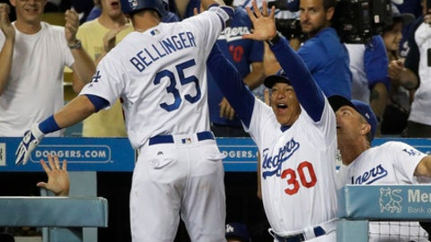 Los Angeles Dodgers' Cody Bellinger, left, is greeted by manager Dave Roberts after hitting three-run home run during the eighth inning of a baseball game against the Minnesota Twins, Monday, July 24, 2017, in Los Angeles. (AP Photo/Jae C. Hong)