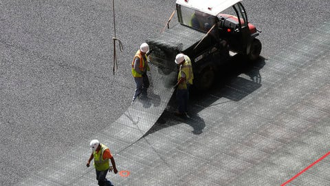 Workers install flooring at Mercedes Benz Stadium, the new home of the Atlanta Falcons football team and the Atlanta United soccer team, in Atlanta. (AP Photo/John Bazemore)