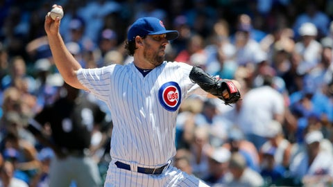 Chicago Cubs starting pitcher John Lackey delivers during the first inning of a baseball game against the Chicago White Sox Tuesday, July 25, 2017, in Chicago. (AP Photo/Charles Rex Arbogast)