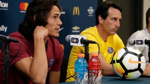 Paris Saint-Germain's Edinson Cavani, left, and coach Unai Emery, right, speak during a news conference in advance of an International Champions Cup soccer match, Tuesday, July 25, 2017, in Miami Gardens, Fla. Paris Saint-Germain plays Juventus on Wednesday. (AP Photo/Lynne Sladky)