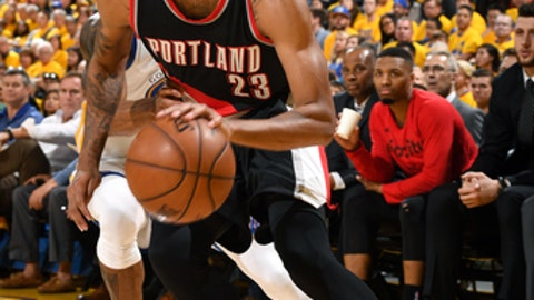 OAKLAND, CA - APRIL 16: Allen Crabbe #23 of the Portland Trail Blazers handles the ball during the game against the Golden State Warriors during the Western Conference Quarterfinals of the 2017 NBA Playoffs on April 16, 2017 at Oracle Arena in Oakland, California. NOTE TO USER: User expressly acknowledges and agrees that, by downloading and or using this photograph, user is consenting to the terms and conditions of Getty Images License Agreement. Mandatory Copyright Notice: Copyright 2017 NBAE (Photo by Garrett Ellwood/NBAE via Getty Images)
