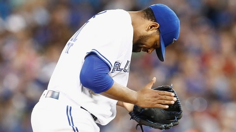 Toronto Blue Jays starting pitcher Cesar Valdez reacts after striking out and Oakland Athletics batter during the sixth inning of a baseball game Tuesday, July 25, 2017, in Toronto. (Mark Blinch/The Canadian Press via AP)