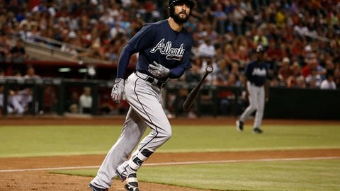 Atlanta Braves' Nick Markakis tosses his bat away after earning a walk against the Arizona Diamondbacks during the fourth inning of a baseball game Tuesday, July 25, 2017, in Phoenix. (AP Photo/Ross D. Franklin)