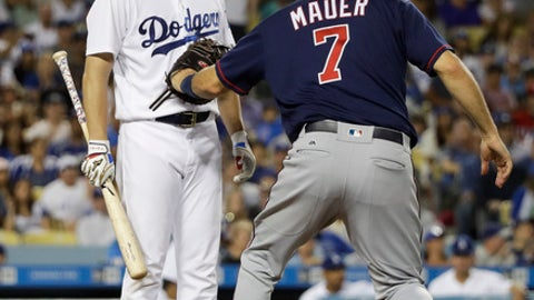 Los Angeles Dodgers starting pitcher Kenta Maeda, left, of Japan, is tagged out by Minnesota Twins' Joe Mauer after hitting a bunt during the third inning of a baseball game, Tuesday, July 25, 2017, in Los Angeles. (AP Photo/Jae C. Hong)