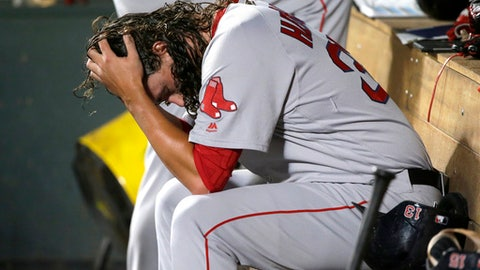 Boston Red Sox pitcher Heath Hembree holds his head in the dugout after being pulled during the seventh inning of the teams baseball game against the Seattle Mariners, Tuesday, July 25, 2017, in Seattle. (AP Photo/Ted S. Warren)