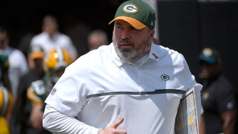 FILE - In this Sept. 11, 2016, file photo, Green Bay Packers head coach Mike McCarthy runs onto the field before an NFL football game against the Jacksonville Jaguars, in Jacksonville, Fla. (AP Photo/Phelan M. Ebenhack, File)