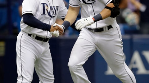 Tampa Bay Rays' Steven Souza Jr., right, shakes hands with third base coach Charlie Montoyo after his home run off Baltimore Orioles relief pitcher Darren O'Day during the seventh inning of a baseball game Wednesday, July 26, 2017, in St. Petersburg, Fla. (AP Photo/Chris O'Meara)