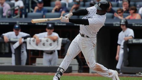 New York Yankees' Didi Gregorius connects for a two-run home run against the Cincinnati Reds during the seventh inning of a baseball game, Wednesday, July 26, 2017, in New York. (AP Photo/Julie Jacobson)