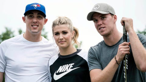 "Eugenie Bouchard, center, Aaron Sanchez, left, and Connor McDavid pose for a photograph after competing in a ""60 Second Scramble"" promotional event ahead of the Rogers Cup tennis tournament on Wednesday, July 26, 2017 in Toronto. (Christopher Katsarov/The Canadian Press via AP)"