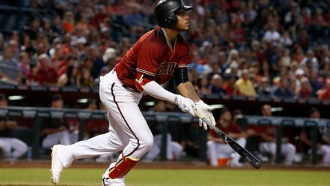 Arizona Diamondbacks' Ketel Marte watches the flight of his fly ball hit the fence against the Atlanta Braves during the third inning of a baseball game Wednesday, July 26, 2017, in Phoenix. Diamondbacks' Marte would get a two-run inside-the-park home run on the play. (AP Photo/Ross D. Franklin)