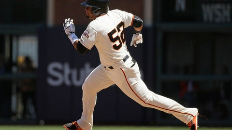 San Francisco Giants' Miguel Gomez runs for second base after hitting a double off Pittsburgh Pirates relief pitcher Tony Watson in the seventh inning of a baseball game Wednesday, July 26, 2017, in San Francisco. (AP Photo/Eric Risberg)
