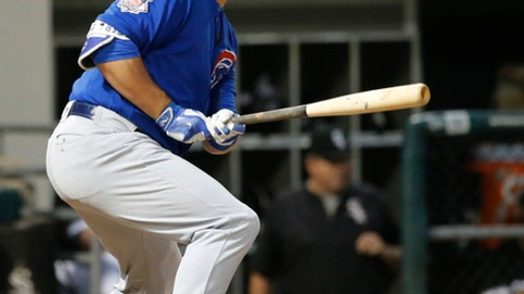 Chicago Cubs' Kyle Schwarber watches his RBI single off Chicago White Sox starting pitcher James Shields during the fourth inning of a baseball game Wednesday, July 26, 2017, in Chicago. (AP Photo/Charles Rex Arbogast)