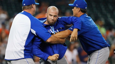 Kansas City Royals' Danny Duffy, center, is held back by assistant hitting coach Brian Buchanan, left, and bench coach Don Wakamatsu as the benches cleared after Mike Moustakas was hit by a Detroit Tigers pitch during the ninth inning of a baseball game in Detroit, Wednesday, July 26, 2017. The Royals won 16-2. (AP Photo/Paul Sancya)
