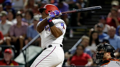 Texas Rangers' Adrian Beltre follows through on a double off Miami Marlins' Nick Wittgren as catcher J.T. Realmuto, right, watches during the seventh inning of a baseball game, Wednesday, July 26, 2017, in Arlington, Texas. The hit was the 2,996th of Beltre's career. (AP Photo/Tony Gutierrez)