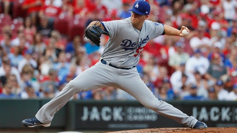 FILE - In this June 16, 2017, file photo, Los Angeles Dodgers starting pitcher Alex Wood throws in the first inning of a baseball game, enroute to a 3-1 win against the Cincinnati Reds, in Cincinnati. With Clayton Kershaw sidelined by injury, the Dodgers are in need of a dominant left-hander. Baseball's best team need look no farther than one locker past Kershaw's in the clubhouse. Alex Wood has been doing his best impression of the three-time NL Cy Young Award winner for the last several weeks. (AP Photo/John Minchillo, File)