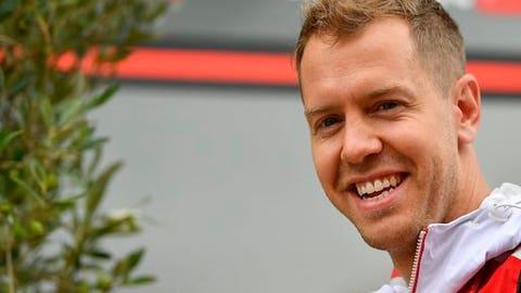 German Formula One driver Sebastian Vettel of Ferrari walks in the paddock at the Hungaroring racetrack in Mogyorod, 23 km northeast of Budapest, Hungary, Thursday, July 27, 2017. The Hungarian Formula One Grand Prix will be held on Sunday July, 30. (Zsolt Czegledi/MTI via AP)