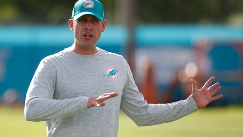 Miami Dolphins head coach Adam Gase talks to players during an NFL football training camp, Thursday, July 27, 2017 at the Dolphins training facility in Davie, Fla. (AP Photo/Wilfredo Lee)
