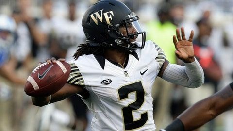 FILE - In this Sept. 10, 2016, file photo, Wake Forest quarterback Kendall Hinton (2) passes against Duke during the second half of an NCAA college football game in Durham, N.C. Now that he's healthy again, Kendall Hinton might not take as many unnecessary chances in his latest stint as Wake Forest's starting quarterback. He's back to 100 percent after a knee injury kept him out of the final 10 games of last season. (AP Photo/Gerry Broome, File)