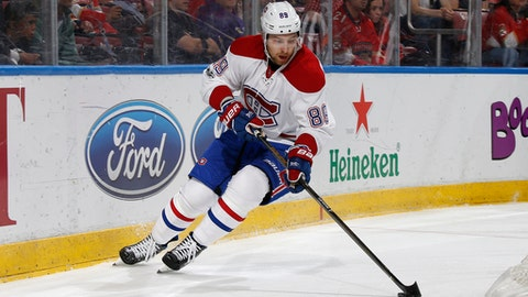 FILE - In this April 3, 2017, file photo, Montreal Canadiens defenseman Andrei Markov (79) moves the puck against the Florida Panthers during the first period of an NHL hockey game in Sunrise, Fla. Markov is leaving the NHL after 16 seasons with the Canadiens to sign in Russia's Kontinental Hockey League. The 38-year-old defenseman hopes to represent Russia in the 2018 Pyeongchang Olympics, which will happen without NHL players(AP Photo/Joel Auerbach, File)