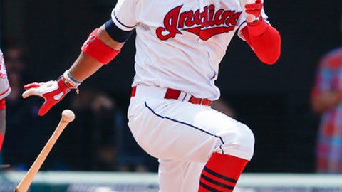 Cleveland Indians' Francisco Lindor hits an RBI single off Los Angeles Angels starting pitcher JC Ramirez during the seventh inning in a baseball game, Thursday, July 27, 2017, in Cleveland. (AP Photo/Ron Schwane)