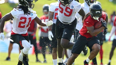 Atlanta Falcons cornerback Desmond Trufant (21) and linebacker De'Vondre Campbell (59) cover running back Devonta Freeman on a pass reception during NFL football training camp on Thursday, July 27, 2017, in Flowery Branch, Ga. (Curtis Compton/Atlanta Journal-Constitution via AP)