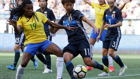 Brazil's Ludmila (19) is challenged by Japan's Mina Tanaka (11) during the first half of a Tournament of Nations women's soccer match, Thursday, July 27, 2017, in Seattle. (AP Photo/Ted S. Warren)