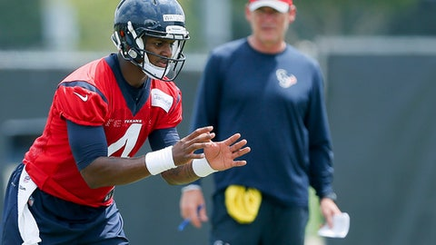 "FILE - In this May 31, 2017, file photo, Houston Texans quarterback Deshaun Watson (4) waits for a snap during the team's organized team activity at its NFL football training facility in Houston. Watson said following the NFL draft that--however soon his time came on the field--he was prepared to do whatever Houston asked of him, saying ""All I need to do is put my head down, don't say anything and learn from the veteran guys."" (AP Photo/Bob Levey, File)"