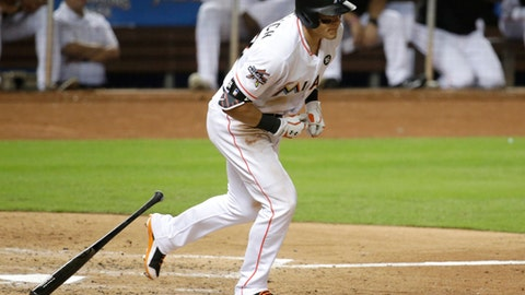 Miami Marlins' Derek Dietrich draws a walk with the bases loaded to score Giancarlo Stanton during the fifth inning against the Cincinnati Reds in a baseball game Thursday, July 27, 2017, in Miami. (AP Photo/Lynne Sladky)
