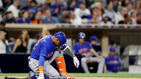 New York Mets' Yoenis Cespedes is slow to get up after a swing during a seventh-inning at-bat in the team's baseball game against the San Diego Padres on Thursday, July 27, 2017, in San Diego. Cespedes his an RBI double during the at-bat. (AP Photo/Gregory Bull)