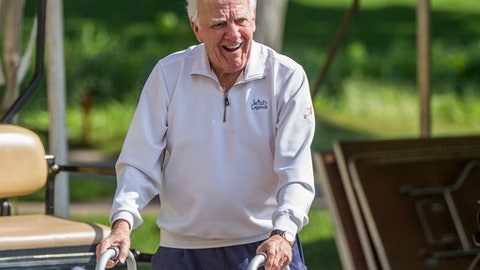 FILE - In this June 13, 2016, file photo, former Notre Dame football coach Ara Parseghian makes his way to an interview area during the Kelly Cares Foundation Golf Invitational at Lost Dunes Golf Club in Bridgman, Mich. Parseghian has returned to his home in Granger, Ind., after spending more than a week in a nursing care facility because of an infection in his surgically repaired hip. (Robert Franklin/South Bend Tribune via AP, File)