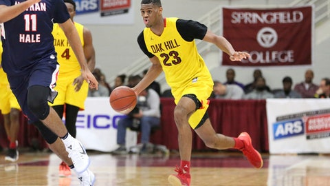 FILE - In this Jan. 16, 2017, file photo, Oak Hill Academy's Billy Preston dribbles upcourt against Nathan Hale during a high school basketball game at the 2017 Hoophall Classic in Springfield, Mass. Kansas has a  trio of incoming freshmen, headlined by four-star point guard Marcus Garrett and potential one-and-done forward Billy Preston.  (AP Photo/Gregory Payan, File)