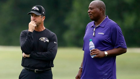 Baltimore Ravens head coach John Harbaugh, left, and general manager and executive vice president Ozzie Newsome watch an NFL football training camp practice in Owings Mills, Md., Friday, July 28, 2017. (AP Photo/Patrick Semansky)