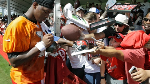 Tampa Bay Buccaneers quarterback Jameis Winston (3) signs autographs for fans after an NFL football training camp practice Friday, July 28, 2017, in Tampa, Fla. (AP Photo/Chris O'Meara)
