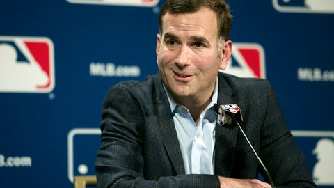 FILE - In this Dec. 7, 2016, file photo, Chicago White Sox general manager Rick Hahn speaks at a news conference in Oxon Hill, Md. While several teams are debating their plans ahead of Monday's non-waiver trade deadline, there are no such questions about the direction on the South Side of Chicago. The 46-year-old Hahn, a proud graduate of the University of Michigan and former player agent, is selling everything that makes sense while stockpiling prospects for his rebuilding project. (AP Photo/Cliff Owen, File)