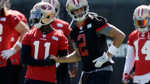 San Francisco 49ers quarterback Brian Hoyer (2) shakes hands with wide receiver Marquis Goodwin during the NFL team's football training camp Friday, July 28, 2017, in Santa Clara, Calif. (AP Photo/Marcio Jose Sanchez)
