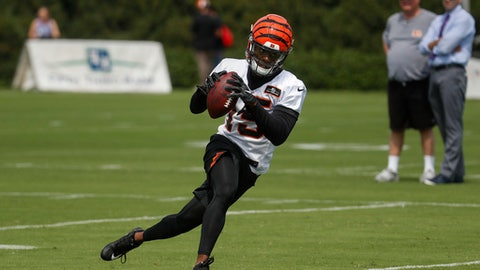 Cincinnati Bengals wide receiver John Ross (15) runs a play as Bengals owner Mike Brown, second from right, watches from the sidelines during an NFL football training camp, Friday, July 28, 2017, in Cincinnati. (AP Photo/John Minchillo)