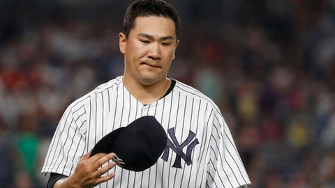 New York Yankees starting pitcher Masahiro Tanaka takes his cap off as he walks to the dugout in the middle of the seventh inning of the team's baseball game against the Tampa Bay Rays, Friday, July 28, 2017, in New York. (AP Photo/Julie Jacobson)