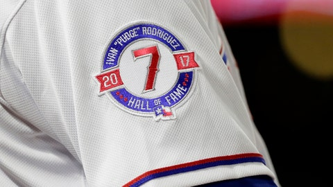 "A patch on the sleeve of Texas Rangers' Carlos Gomez recognizes former Rangers catcher Ivan ""Pudge"" Rodriguez in the seventh inning of a baseball game against the Baltimore Orioles, Friday, July 28, 2017, in Arlington, Texas. The team and coaching staff will wear the patch throughout the weekend series celebrating Ivan's induction into the Baseball Hall of Fame. (AP Photo/Tony Gutierrez)"
