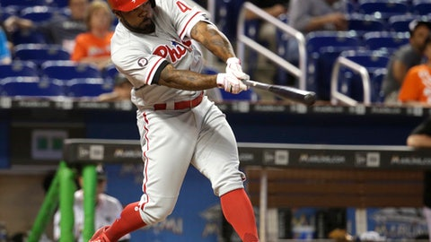 FILE - In this May 31, 2017, file photo, Philadelphia Phillies' Howie Kendrick hits a single against the Miami Marlins during a baseball game in Miami. Kendrick has been traded from the Phillies to the Washington Nationals for minor league pitcher McKenzie Mills. As part of the deal announced Friday night, July 28, the Phillies will send cash to the Nationals to cover part of the $3.55 million remaining in Kendrick's $10 million salary. (AP Photo/Lynne Sladky, File)