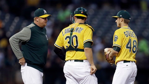 Oakland Athletics pitching coach Scott Emerson, left, meets with Daniel Gossett, right, and Ryan Lavarnway (30) during the fourth inning of the team's baseball game against the Minnesota Twins on Friday, July 28, 2017, in Oakland, Calif. (AP Photo/Ben Margot)