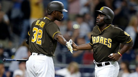 San Diego Padres' Jose Pirela, right, gets congratulations from Jabari Blash after scoring on a triple by Cory Spangenberg during the sixth inning of a baseball game against the Pittsburgh Pirates in San Diego, Friday, July 28, 2017. (AP Photo/Alex Gallardo)