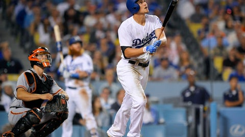 Los Angeles Dodgers' Corey Seager watches a two-run home run in front of San Francisco Giants catcher Nick Hundley during the seventh inning of a baseball game, Friday, July 28, 2017, in Los Angeles. (AP Photo/Mark J. Terrill)