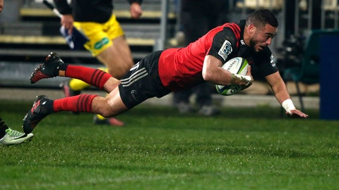 Crusaders Bryn Hall dives across the line to score a try against the Chiefs during their Super Rugby semifinal in Christchurch, New Zealand, Saturday, July 29, 2017. (AP Photo/Mark Baker)