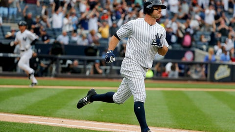 New York Yankees' Brett Gardner, right, heads up the first base line after hitting an RBI base hit that allowed Jacoby Ellsbury to score the winning run against the Tampa Bay Rays during the ninth inning of a baseball game, Saturday, July 29, 2017, in New York. The Yankees won 5-4. (AP Photo/Julie Jacobson)